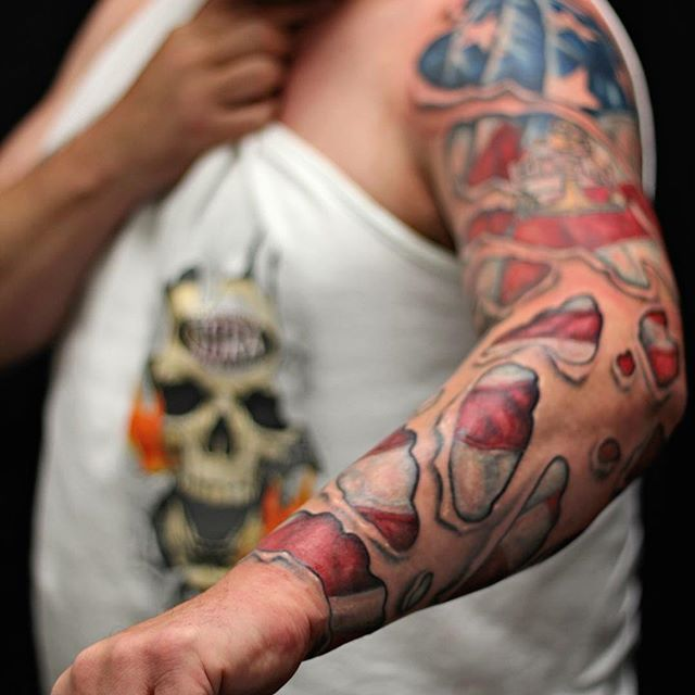 Tear Through American Flag Sleeve Tattoo
