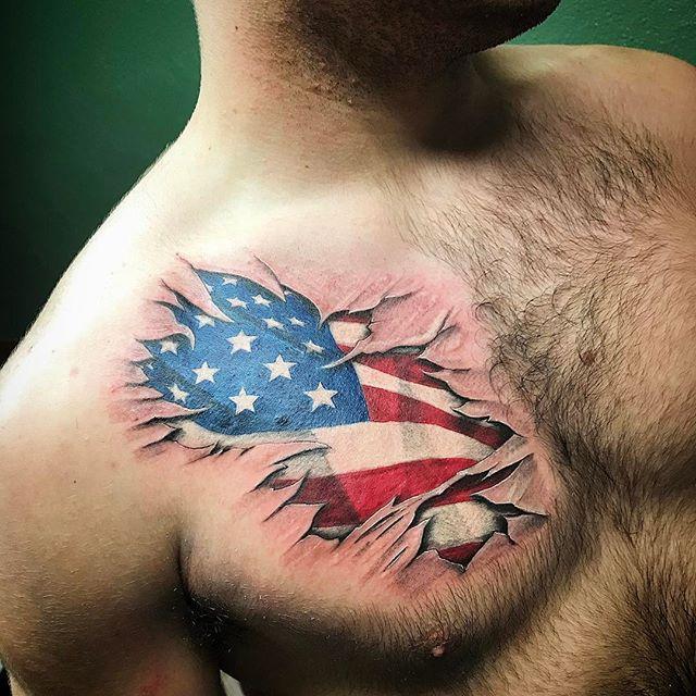 American Flag Tear Through Chest Tattoo